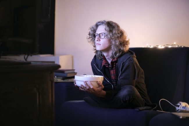 Indie Filmmaker watching indie films at home