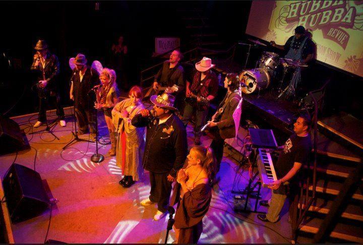 Ryan Greene AKA Chikenhead Johnson on stage with band